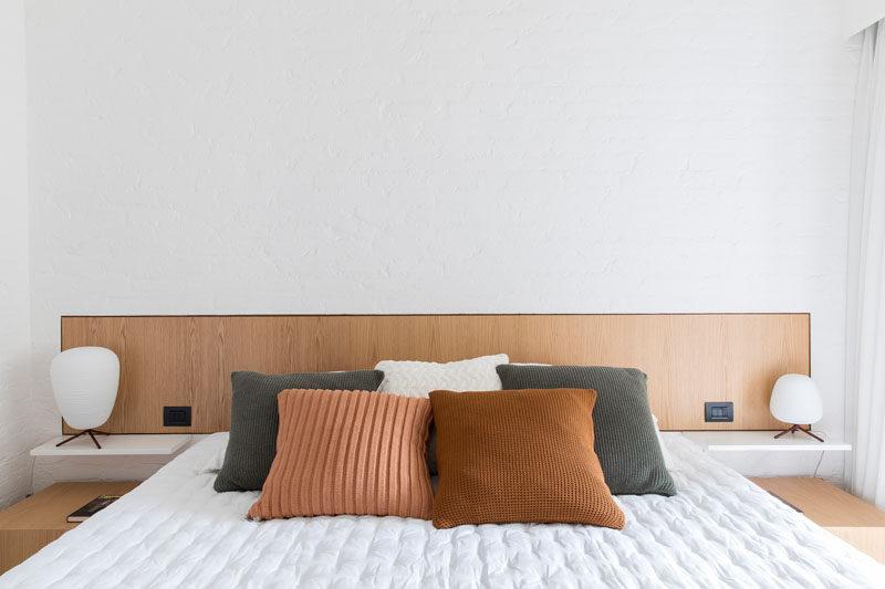5bab04fe53bf3modern-bedroom-with-wood-headboard-250918-135-12-800x533