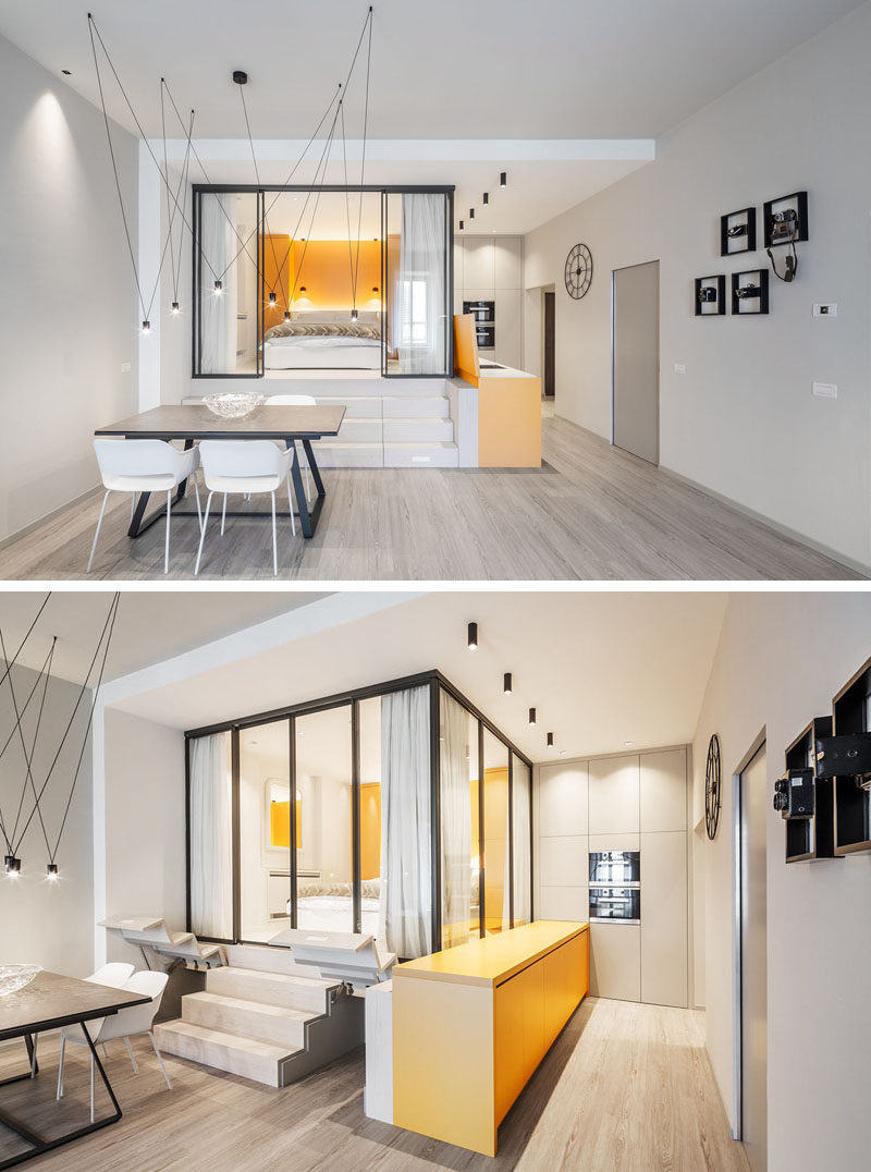Small Apartment Ideas - This small apartment has a glass enclosed bedroom, that's raised up from the rest of the apartment, taking advantage of the ceiling height, and creating additional storage space that's accessed via the stairs. #SmallApartmentIdeas #SmallApartment #GlassWalls #BedroomIdeas #StorageIdeas