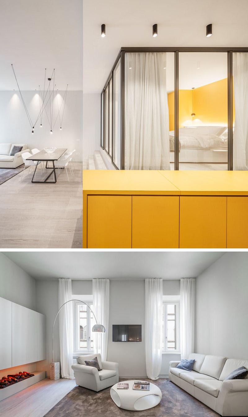 Small Apartment Ideas - This small apartment has a hidden kitchen within a yellow sideboard, a glass enclosed bedroom, and storage hidden under the stairs.