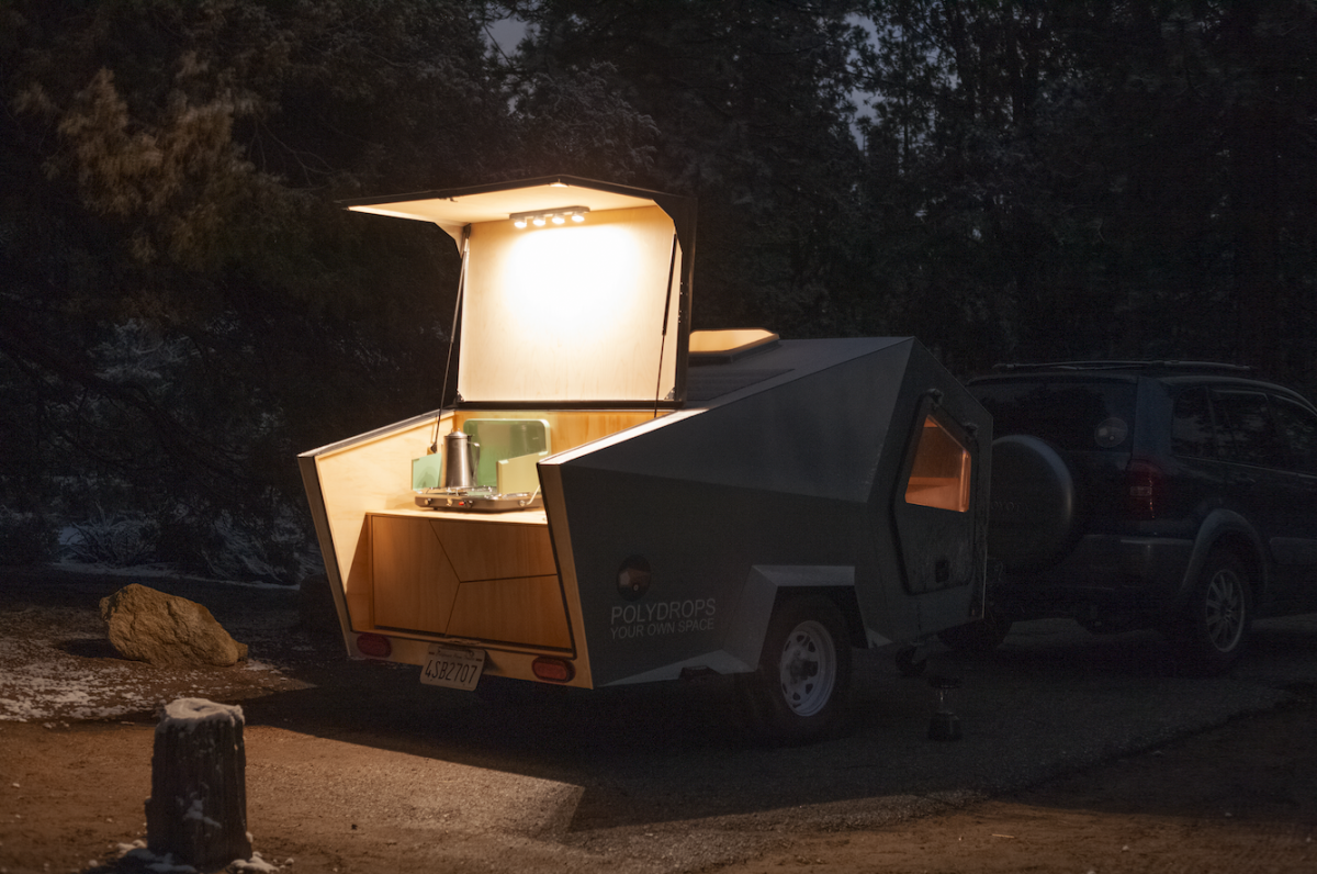 The cooler will have to goin your car, but the Polydrop kitchen does have room for a portable camping stove